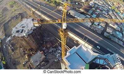 Construction site with crane shot from UAV quadcopter