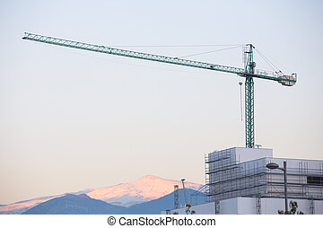 Construction site with crane. Sierra Nevada in the background.
