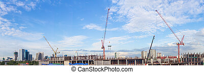 Construction site with crane worker and building as panorama