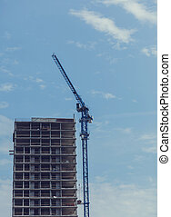 Construction site with cranes and building