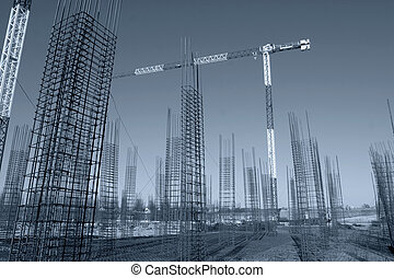 Construction site with enforced concrete steel frames rising...