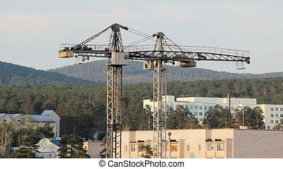 Construction site with two working tower cranes