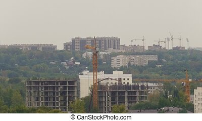 Construction site with workers, crane and unfinished building