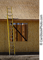 Construction Site with Yellow Ladder Rough Boards