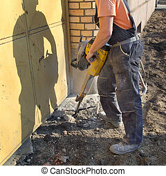 Construction site, worker and jackhammer tool - Worker at...
