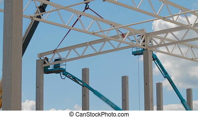 Construction site workers. Modern Warehouse building -...