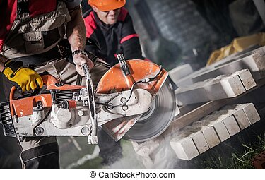Construction Site Works. Caucasian Workers Cutting Concrete...