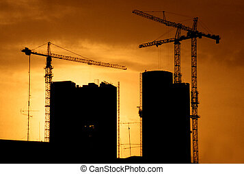 Construction skyline - building construction with cranes and...