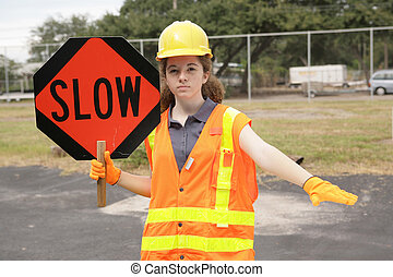 Construction Slow Sign - A female construction worker...