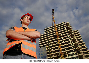 Construction supervisor in safety helmet and reflex vest in...