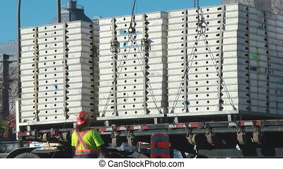 Construction Supplies Being Offloaded From An Eighteen...