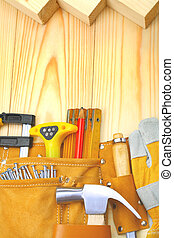 construction tools in belt on wooden boards