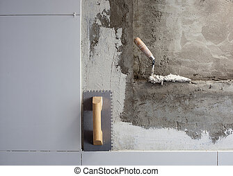 construction tools notched trowel with mortar