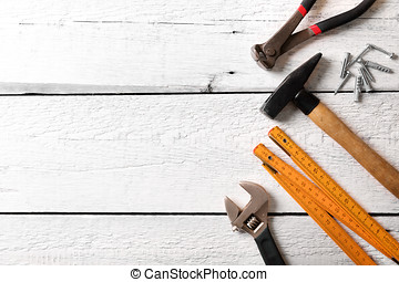 construction tools on white wood background with copy space