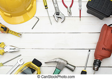 construction tools on wood background