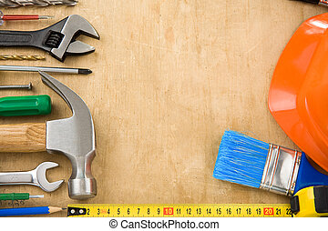 construction tools on wood texture