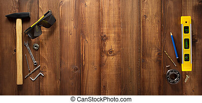 construction tools on wooden  background