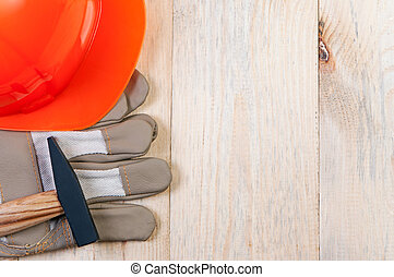 Construction tools on wooden board.