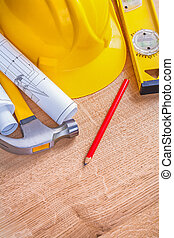 construction tools on wooden board with small copyspace