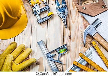 construction tools set on wooden background