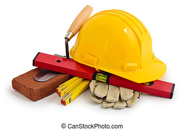 Construction tools. - Yellow safety hard hat and ...