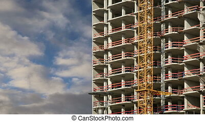Construction tower crane at a construction site
