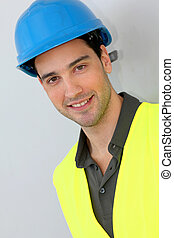 Construction trainee with security helmet
