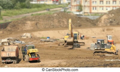 Construction vehicles and builders outdoors - Construction...