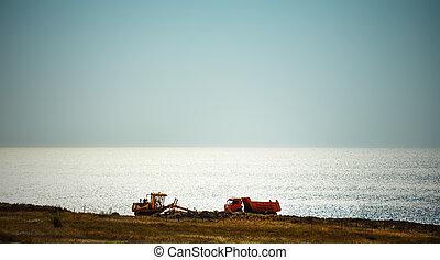 construction vehicles on the wild coast