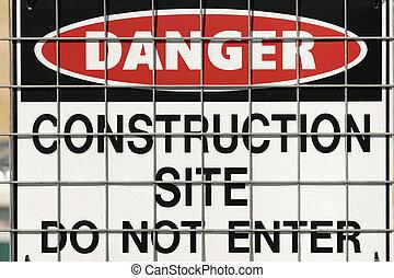 Construction warning sign - Warning sign on fence.