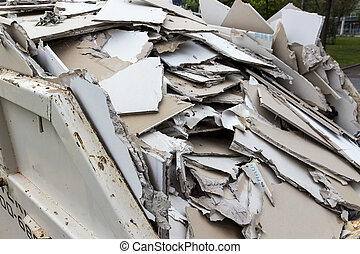 construction waste. plasterboard in container - in a waste...