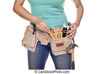 Construction woman. - A woman wearing a DIY tool belt full ...