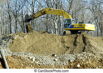 Construction Work - A crane digging up the soil to build ...