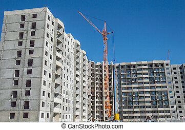 Construction work site and hoisting tower cranes