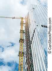 Construction work site on blue sky background