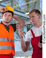 Construction worker and engineer