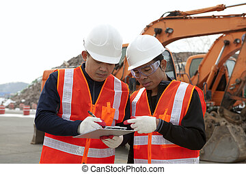 construction worker and excavator