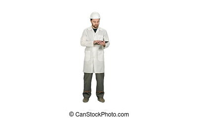 Construction worker and new building, man with safety helmet and using digital tablet computer on white background.
