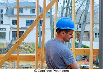 Construction Worker Building Timber Frame New Home