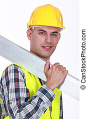 Construction worker carrying metal