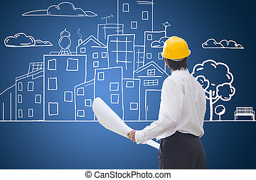 Construction worker checking blueprints and hand drawing city. construction and building eco conceptual