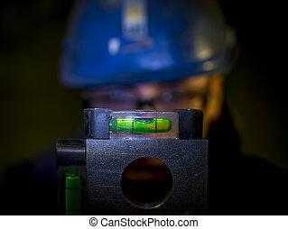 spirit level - construction worker checking spirit level or ...