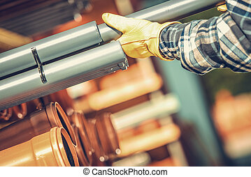 Construction Worker Choosing Right Plastic Pipes