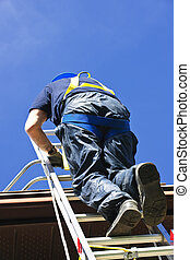 Construction worker climbing ladder - Construction worker...