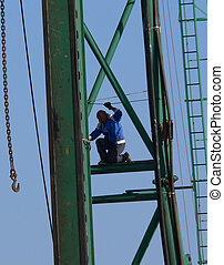 Construction Worker - Construction worker balancing on high...