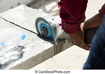 construction worker  cuting cement