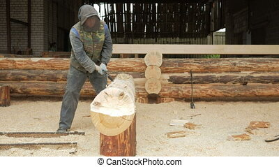 Construction worker cuts a groove in the tree for a future...
