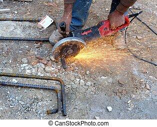 Construction worker cuts rebar circ