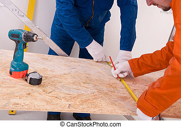 Construction worker doing measuring