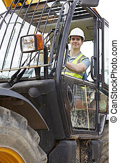 Construction Worker Driving Digger On Building Site